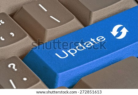Keyboard with key for update - stock photo