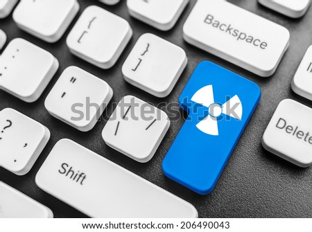 Keyboard with radioactive blue button. Concept image. - stock photo