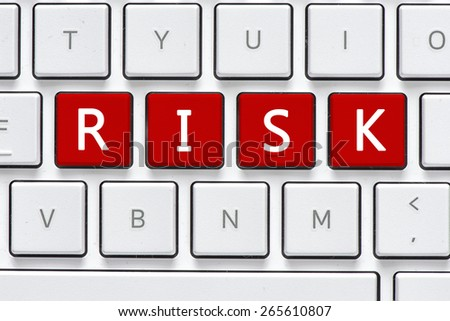 Keyboard with risk button. Computer white keyboard with risk button - stock photo