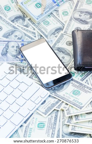 keyboard with wallet and modern phone, white copy space on screen on money background - stock photo