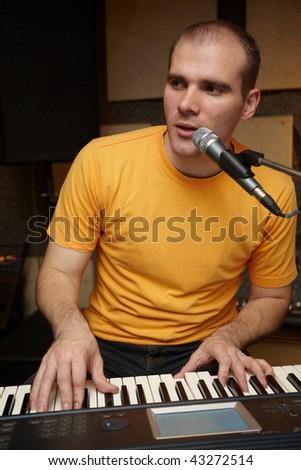 keyboarder playing near microphone - stock photo