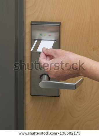 Keycard being inserted in electronic lock - stock photo