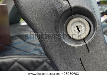 Keyhole for starting an old car - stock photo