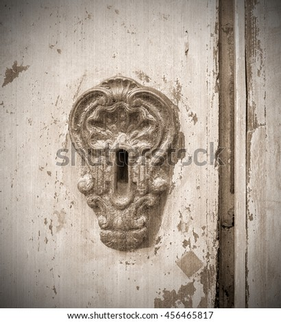Keyhole in of an old door. Old style. Sepia - stock photo