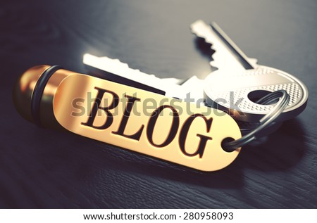 Keys and Golden Keyring with the Word Blog over Black Wooden Table with Blur Effect. Toned Image. - stock photo