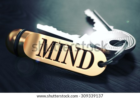 Keys and Golden Keyring with the Word Mind over Black Wooden Table with Blur Effect. Toned Image. - stock photo