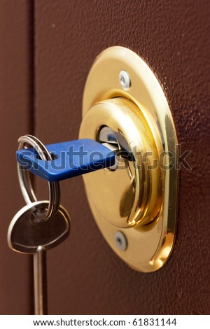 Keys and secure lock in steel door of new apartment - stock photo