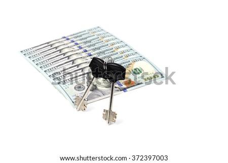 Keys are lying on hundred-dollar bills. Isolated - stock photo