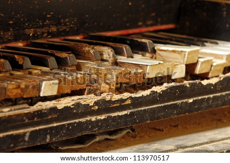 keys of an old piano damaged by time - stock photo