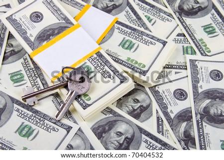 Keys of one hundred dollar bills background - stock photo
