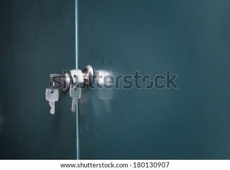 Keys on a locker door - stock photo