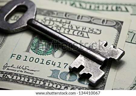 Keys on a one hundred dollar banknote - stock photo
