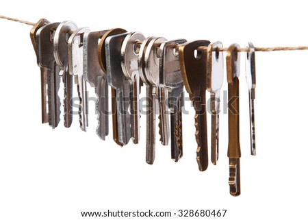 Keys on the thread  over white background - stock photo