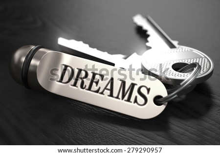 Keys to Dreams - Concept on Golden Keychain over Black Wooden Background. Closeup View, Selective Focus, 3D Render. Black and White Image. - stock photo