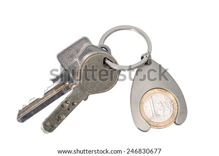 Keys with trinket isolated on white background - stock photo
