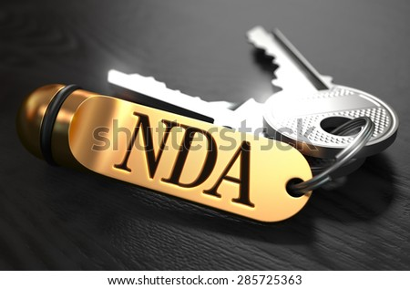 Keys with Word NDA - Non Disclosure Agreement - on Golden Label over Black Wooden Background. Closeup View, Selective Focus, 3D Render. - stock photo