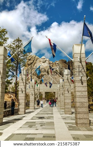 KEYSTONE, SD - MAY 10: Mount Rushmore monument with tourists on May 10, 2014 near Keystone, SD. It's a sculpture carved into the granite features 60-foot sculptures of the heads of 4 US presidents. - stock photo