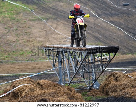 """KHABAROVSK RUSSIAN - MAY 21: Gulyako Fedor in action at the first stage of the Khabarovsk enduro """"KHABARIGENS 2011 May 21, 2011 in Khabarovsk, Russia - stock photo"""