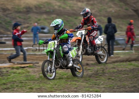 """KHABAROVSK RUSSIAN - MAY 21: 8 - Ilya Solomin, 19 - Sergei Nazarenko in action at the first stage of the Khabarovsk enduro """"KHABARIGENS 2011 May 21, 2011 in Khabarovsk, Russia - stock photo"""