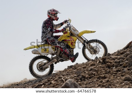 KHABAROVSK RUSSIAN- SEPTEMBER 26: -Alexei Alexandrov in action at  The second stage of the Khabarovsk enduro KHABARIGENS 2010 on September 26, 2010 in Khabarovsk Russia - stock photo