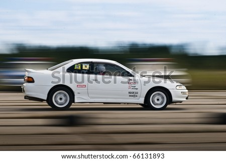 """KHABAROVSK ,RUSSIAN - SEPTEMBER 10: Kim Alexander in action at Round 5 competition """"DRAG RACING in Khabarovsk"""" on September 10, 2010 in Khabarovsk, Russia - stock photo"""