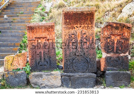 Khachkars are commonly use as tombstone but sometime are also use as memorials. - stock photo
