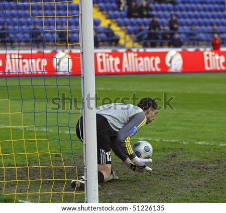 KHARKIV, UKRAINE - APRIL 15: FC Ilyichevets (Mariupol) goalkeeper Oleg Ostapenko in action during soccer match vs. FC Metalist (Kharkiv), April 15, 2010 in Kharkov, Ukraine - stock photo