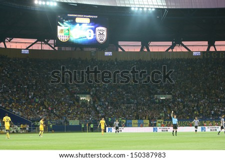 KHARKIV, UKRAINE -AUG 07:Wide view of the UEFA Champions League soccer match METALIST vs PAOK at Metalist Arena on August 07,2013 in Kharkiv, Ukraine. - stock photo