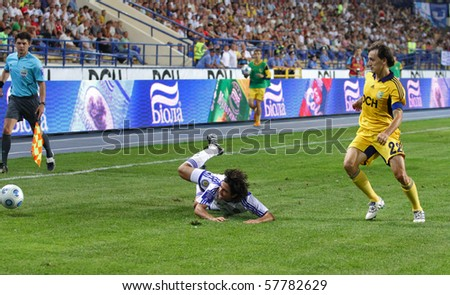 KHARKIV, UKRAINE -JULY 23: FC Dynamo MF Facundo Bertoglio (L) in action vs. FC Metalist Kharkiv (1:2) football match, July 23, 2010 in Kharkov, Ukraine - stock photo