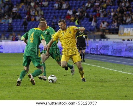 KHARKIV, UKRAINE - MAY 25:Andriy Shevchenko (R) in action during Ukraine - Lithuania (4:0) national teams friendly football match, May 25, 2010 in Kharkov, Ukraine - stock photo