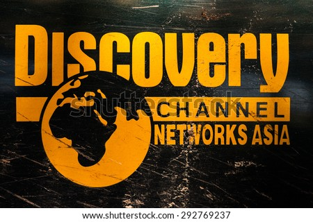 "Kharkiv, Ukraine - May 12, 2015: The sticker on the car ""Discovery travel channel networks asia"" door SUV. The car during a trip to Ukraine. - stock photo"