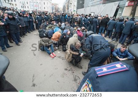 Kharkov, Ukraine - March 1, 2014: Kharkov Regional defend the sovereign administration of the police cordon avoiding lynching townspeople,Sumskaya str.  - stock photo