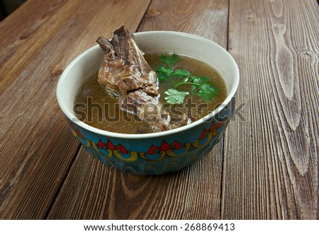 Khash - dish of boiled cow's feet. traditional dish in Afghanistan, Armenia, Azerbaijan, Bosnia and Hercegovina, Bulgaria, Georgia, Iran, Iraq, and Turkey. - stock photo