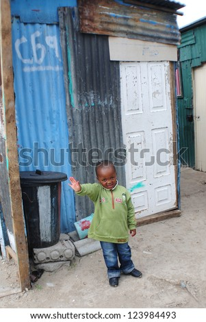 KHAYELITSHA, CAPE TOWN - MAY 22 : A unidentified child on a street of Khayelitsha township on May 22, 2007, Cape Town, South Africa. There are many children abandoned in the streets alone - stock photo