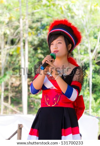 "KHEK NOI, PHETCHABUN, THAILAND -DECEMBER 14: Hmong tribal Girls with clothes ""Hmong Girls singing in the Hmong New Year Festival"" on December 14, 2012 in Phetchabun Thailand - stock photo"