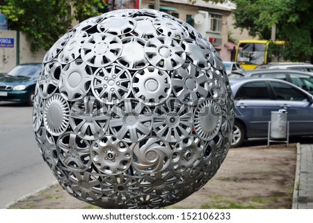 KHERSON, UKRAINE - AUG 27: close view of advertising ball made of hubcaps near tire repair shop of official Hyundai and KIA service station taken on August 27, 2013 in Kherson, Ukraine. - stock photo