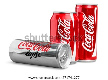 KHERSON, UKRAINE - NOVEMBER 24, 2014: Coke. 330ml Coca-Cola Bottle Cans Isolated On White Background. Coca-Cola is a carbonated soft drink sold in stores, restaurants, and vending machines around the - stock photo