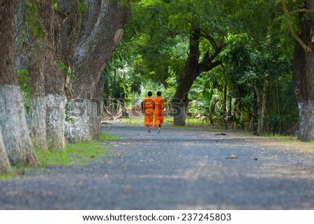 Khmer young monks walking morning to ask for alms in An Giang, Mekong Delta, Vietnam - stock photo