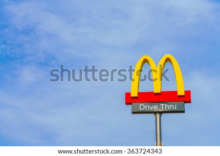 Khonkaen Province, Thailand - December 20, 2015 : McDonalds logo on blue sky McDonald's Corporation is the world's largest chain of hamburger fast food restaurants. - stock photo