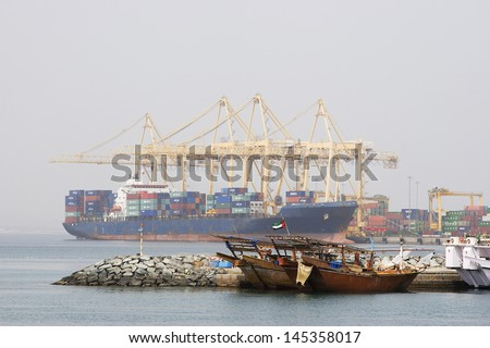 Khor Fakkan UAE Large cargo ships docked to load and unload goods at Khor Fakkport - stock photo