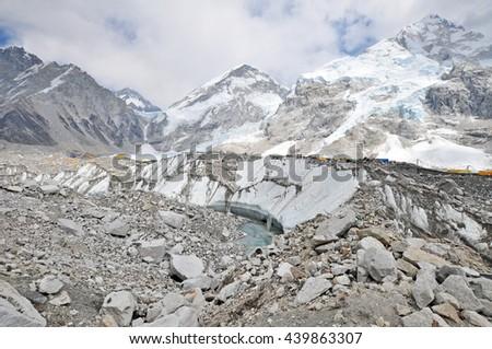 Khumbu Glacier and himalaya peaks. Himalayas mountain panorama - view from way to Everest Base Camp - Sagarmatha National Park, Nepal. - stock photo
