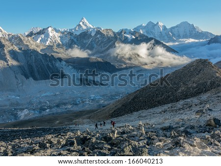 Khumbu Glacier and tourists who descend from  Kala Patthar (5600 m) - Everest region, Nepal, Himalayas - stock photo