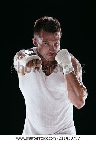 kick-boxer training before fight - stock photo