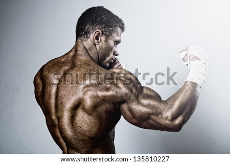 kick-boxer training before fight.Kickboxing or muay thai - stock photo