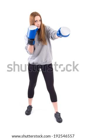 Kickboxing girl exercise in studio. Isolated on a white background. Studio shot - stock photo