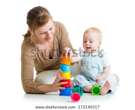 kid and mother playing together with toys - stock photo