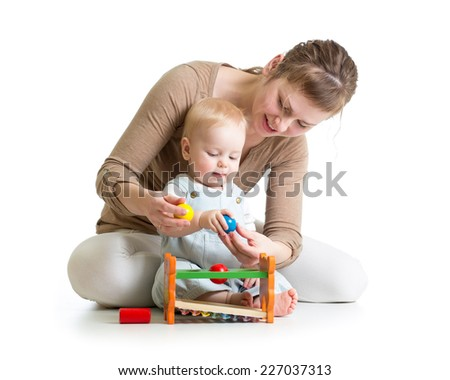 kid and mother playing  with musical toy - stock photo