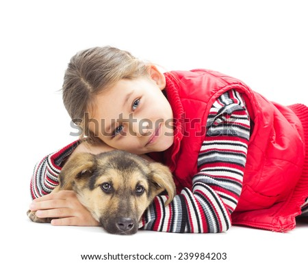 kid and puppy lying on a white background isolated - stock photo