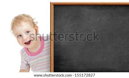 kid behind blank blackboard - stock photo