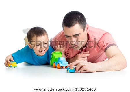Kid boy and father play with car toys - stock photo